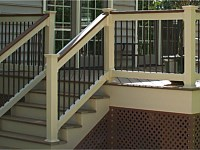 <b>Tan Lincoln Vinyl railing with cocktail rail and bronze aluminum balusters</b>
