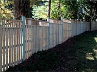 <b>Board on Board Wood Privacy Fence with Closed Spindle Top</b>