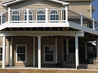 <b>Wrapping the sides of the deck and the structural supports with vinyl and composite materials created a clean, polished look for your new outdoor room.</b>