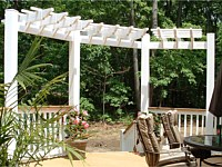 <b>A trellis adds a beautiful architectural structure to your space and gives the illusion of walls for an outdoor deck. This trellis creates quite a statement and frames both the view and the stairs leading away from the deck.</b>