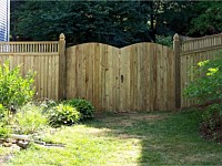 <b>Board on Board closed top spindle wood privacy fence with double arched gate</b>