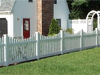 <b>Scalloped Dog Ear Contemporary Picket White Vinyl Fence plus in the background Tongue and Groove White Vinyl Privacy Fence with Lattice Top and Arbor over a Gate</b>