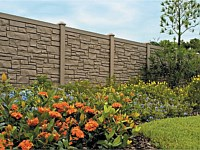 <b>Brown Granite Ecostone Simtek Fence bordered by a flower bed</b>
