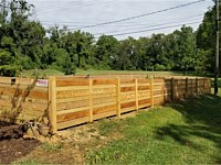 <b>4 foot high Cedar Horizontal Fence with alternating sized boards and dog ear posts</b>