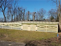 <b>4 foot high pressure treated wood Crossbuck style fence with double arched gate</b>
