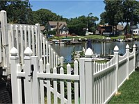 <b>4 foot high white contemporary spaced pointed picket vinyl fence with scalloped layout and french gothic post caps</b>