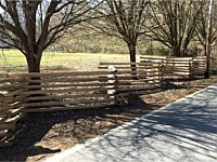 <b>Custom Battlefield Fence with Battlefield rail or snake rail which is split, not saw cut, for a true rustic appearance, and is pressure treated for longevity.</b>