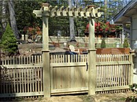 <b>Spaced Picket Wood Fence with Wood Arbor</b>