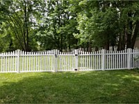<b>5' high white pvc picket fence in contemporary style with pointed pickets and new england post caps with a concave pattern-2</b>