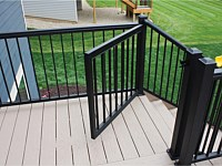 <b>Add Security with a Gate! Gates offer an extra level of safety and accessibility for any deck design. Create a contained, safe place for your young children or your pets by adding a gate to your new outdoor room.</b>
