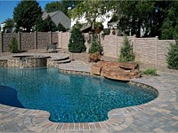 <b>Brown Granite Ecostone Simtek Fence surrounding pool</b>