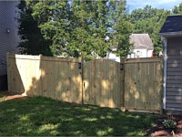 <b>6 foot high Pressure Treated Vertical Board Fence with Facia Board on Top and Bottom and Dog Earred Posts-Arched Walk Gate</b>