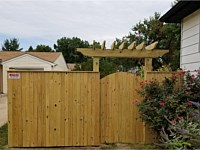 <b>6 foot high Pressure Treated Vertical Board Privacy Fence with an arched walk gate-Trellis over the gate</b>