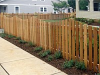 <b>Wood Picket Fence with a Concave Dip and French Gothic Posts</b>