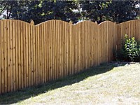 <b>Convex Arched Board and Batten Wood Privacy Fence with French Gothic Posts</b>