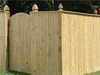 <b>Vertical Board Wood Privacy Fence with French Gothic Posts and a single walk gate</b>