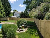 <b>Custom Vertical Board Pressure Treated Fence with Dado Custom 6 x 6 Posts-Mid Rail and Cap Rail</b>