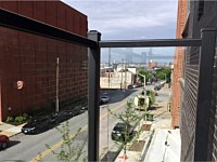 <b>Glass panel and aluminum balcony railing at The National in Baltimore City, MD</b>