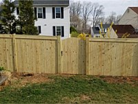 <b>Pressure Treated Privacy Fence with Fascia and arched walk gate</b>