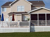 <b>Screened Porch and deck with composite deck boards and white vinyl railing. Gable style roof and a screening system using Screeneze and Super Screen Mesh. Gabled area is finished with siding. Structure is wrapped with white fascia wrap and vinyl lattice.</b>