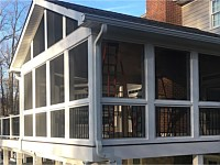<b>Screened Porch with a gable style roof, Screeneze and Super Screen Mesh, Composite deck boards with white vinyl railing and black aluminum balusters. The entire deck is wrapped with white fascia board, and the support beams and posts are also wrapped in vinyl. </b>