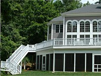 <b>Screened porch under the deck. Deck has composite deck boards and white vinyl railing. Dek Drain is used to provide for under-the-deck dry space.</b>