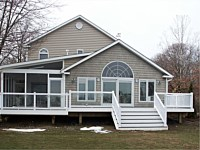 <b>Shed style screened porch with a screening system that includes Screeneze and Super Screen Mesh.  Composite deck boards and aluminum railing with glass panel infills complete the deck.</b>