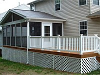 <b>Screened porch with gable style roof and the screening system includes Screeneze and Super Screen Mesh. Both deck and screened porch have composite deck boards and white vinyl railing with black aluminum balusters. The side of the deck is wrapped in matching fascia board, and the underside of the deck is wrapped in white vinyl lattice.</b>