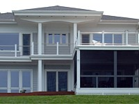 <b>Screened porch with overhead deck. The screening system includes Screeneze and Super Screen Mesh. The overhead deck has composite deck boards and cable rail attached to composite posts.</b>