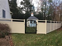 <b>Tan Vinyl Privacy Fence with Black Aluminum Spindle Top and Custom Arched Aluminum Gate</b>