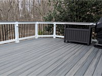 <b>TimberTech Azek Island Oak Decking with White Lincoln Vinyl railing with continuous Cocktail Rail and Eye Ball Lights in Posts</b>