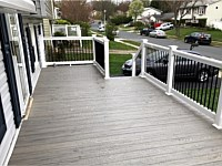 <b>TimberTech Reserve Driftwood Decking with White Washington Railing with Black Aluminum Balusters - Front Porch in Gambrills MD</b>