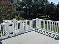 <b>TimberTech Terrain Stone Ash Deck Boards with White Washington Vinyl Railing and gate at the top of the stairs in Hyattsville MD</b>