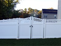 <b>White Vinyl Privacy Fencing with Lattice top and double arched gate</b>
